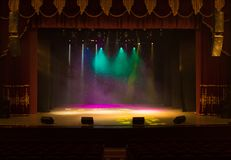 An empty stage of the theater, lit by spotlights and smoke. Before the performance stock images