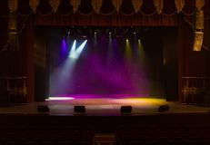 An empty stage of the theater, lit by spotlights and smoke. Before the performance royalty free stock photo