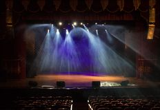 An empty stage of the theater, lit by spotlights and smoke Royalty Free Stock Images