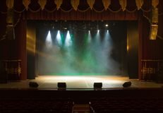 An empty stage of the theater, lit by spotlights and smoke. Before the performance royalty free stock photography