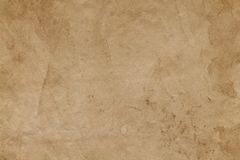 Empty stained old brown paper surface. Abstract background. Or texture stock images
