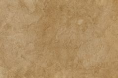 Empty stained old brown paper surface. Background or texture. Empty stained old brown paper surface. Abstract background or texture royalty free stock photo