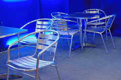 Empty stainless steel chairs and tables Royalty Free Stock Image