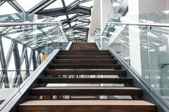 Empty stairs in modern office building interior. Empty stairs, steel and glass structure in modern interior of contemporary office building stock images