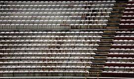 Empty stands and bleachers without people at football stadium Stock Photos