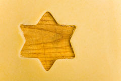 Empty star shape on cookie dough Royalty Free Stock Photo