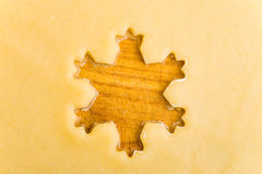 Empty star shape on raw cookie Royalty Free Stock Photo