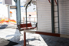 Empty station of ski lift with chairs in a ski-resort. In winter period Stock Photo