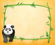An empty stationery with a bamboo frame and a panda Royalty Free Stock Photo