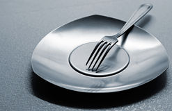 Empty steel plate with fork Stock Photography