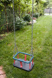 Empty steel swing waiting for children to come on swinging Royalty Free Stock Photo