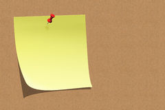 Empty sticky note on board. Empty sticky note and push pin on board Stock Images