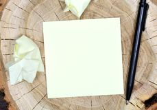 Empty sticky note paper with pen on table. Empty sticky note paper with pen on wood table royalty free stock images