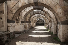 Empty stone corridor with arcs and columns. Ruins of Ancient city Smyrna. Izmir, Turkey Stock Images