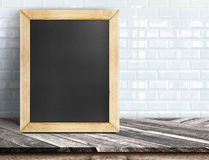 Empty stone marble table and blurred pale plank wooden wall in b Royalty Free Stock Photo