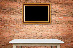 Empty stone table and gold vintage wooden photo frame hang on th Royalty Free Stock Photo