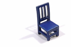 Empty stool. Funny tiny blue ceramic chair on white Stock Images