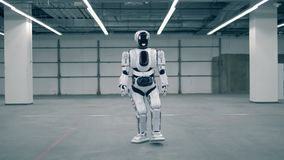 Empty storage room with a robot walking along it. 4K stock video