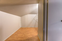 Empty storage space with nice walls and wood floors in San Diego townhouse. Storage spaces in homes. Real estate photos from southern California Royalty Free Stock Image