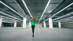 Empty storage unit with a female violinist playing the instrument. 4K stock video