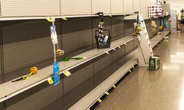 Empty Store Shelves Due To Hording Of Toilet Paper During Corona Virus Pandemic Stock Images