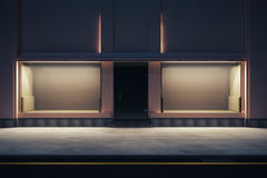 Empty storefront at nighttime. Front view of empty storefront at night. Mock up, 3D Rendering Stock Image