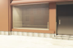 Empty storefront side. Side view of empty clean storefront in daylight. Mock up, 3D Rendering Stock Photo