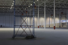 Empty Storehouse With Scaffold. Large empty storehouse with scaffold Stock Photos