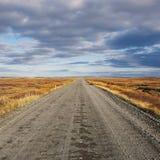 Empty straight gravel road Stock Image