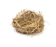 Empty straw nest with twigs on a white background Stock Photos