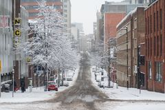 Empty street in the Birmingham City Centre on the snowy day. Empty street in the City centre due to snow and all buses cancellation Royalty Free Stock Images