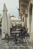 Empty street cafe. Rainy day. Rainy morning in the city. Empty street cafe. Romantic walk through the ancient city of Lviv, Ukraine Royalty Free Stock Image