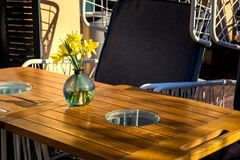 An empty street cafe with a wooden table. stock photography