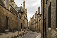 Street in Cambridge, UK. Empty street in Cambridge, UK with the walls of old buildings Royalty Free Stock Photography