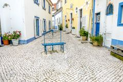 Ericeira, Portugal. Empty street in a coastal village of Ericeira, Portugal Stock Images