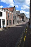 Empty street in the Dutch town Muiden with Muiderslot, Muiden Castle, Holland, the Netherlands stock images