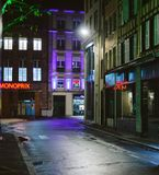 Empty street in France at night with monoprix supermarket Royalty Free Stock Images
