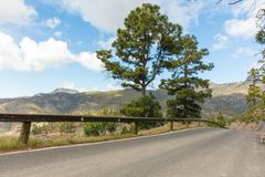 Empty street with guardrail in Spain. Mountain landscape road Stock Image