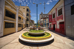 Empty street leading to the town centre in Tumbes Peru. March 19, 2017 Tumbes, Peru: empty street leading to the town center on a hot day Stock Photos