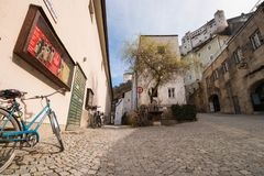 Empty street in the old town of Salzburg, under Festungsberg mountain and Hohensalzburg castle, Austria Stock Images