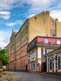 Empty street of old town on summer evening. Cobblestone pavement on the ground. beautiful scenery with architecture of Austria-Hungary times royalty free stock images