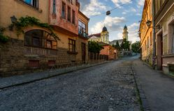 Empty street of old town on summer morning. Cobblestone pavement on the ground. beautiful scenery with architecture of Austria-Hungary times Royalty Free Stock Images