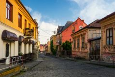 Empty street of old town on summer morning. Cobblestone pavement on the ground. beautiful scenery with architecture of Austria-Hungary times Stock Image