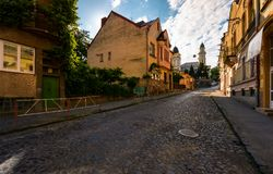 Empty street of old town on summer morning. Cobblestone pavement on the ground. beautiful scenery with architecture of Austria-Hungary times stock photos