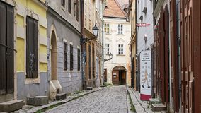 Empty Street Scene in atmospheric Bratislava Slovakia. Bratislava, Slovakia - Aug 2018: Characterful street with cobblestones but no people exudes Eastern royalty free stock photos