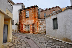 Empty street in small deserted village, greece Stock Image