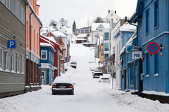 Empty street of Tromso covered by snow Stock Photos