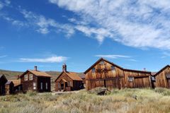 Empty streets of the abandoned ghost town of Bodie in California, USA in the middle of the day royalty free stock images