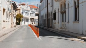 Empty streets with white buildings and houses of historical part of resort city. Deserted boulevard of Paphos city