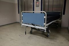 Empty stretcher front of hospital lift stock photography